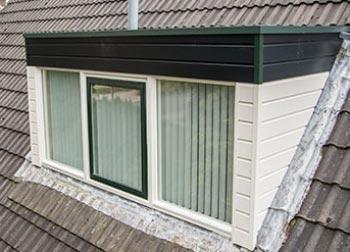 Drie PVC ramen in een dakkapel